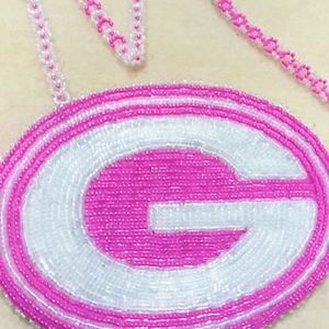 Pink & White beaded GB Packer Medallion.